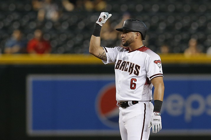 Arizona Diamondbacks' David Peralta reacts after hitting a double against the Colorado Rockies in the seventh inning during a game, Monday, Aug. 19, 2019, in Phoenix. The left fielder will undergo season-ending surgery on his shoulder, which has been injured for a majority of this year. (Rick Scuteri/AP)