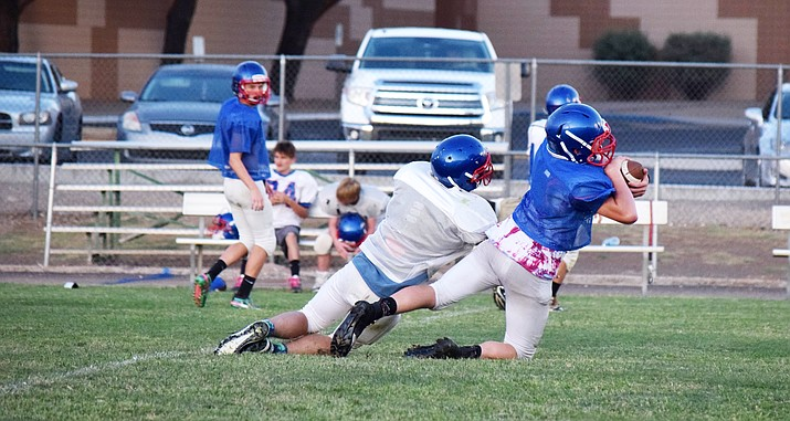 Camp Verde sophomore Kayden Boggess pulls down an interception during practice on Tuesday. VVN/James Kelley