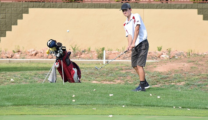 Mingus senior Noah Daher chips the ball into the hole on the ninth at Agave Highlands during the Marauders' match on Tuesday. He got an eagle. VVN/James Kelley