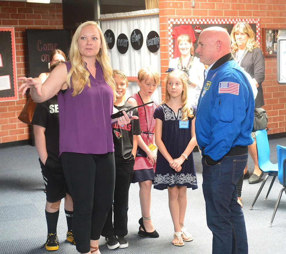 Former astronaut Mark Kelly gets a tour of the school with Principal Kelsey Seccor as he visits Taylor Hicks Elementary School in Prescott Thursday, Aug. 29, 2019.  (Les Stukenberg/Courier)