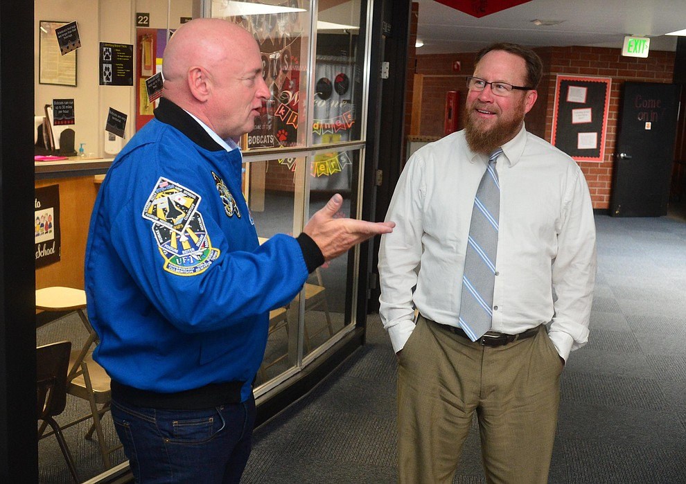 Former astronaut Mark Kelly talks with Superintendent Joe Howard as he visits Taylor Hicks Elementary School in Prescott Thursday, Aug. 29, 2019.  (Les Stukenberg/Courier)