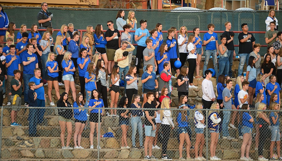 Prescott fans stand for the National Anthem as the Badgers held their 2019 home opener at Ken Lindley Field Friday, Aug. 30, 2019.  (Les Stukenberg/Courier)