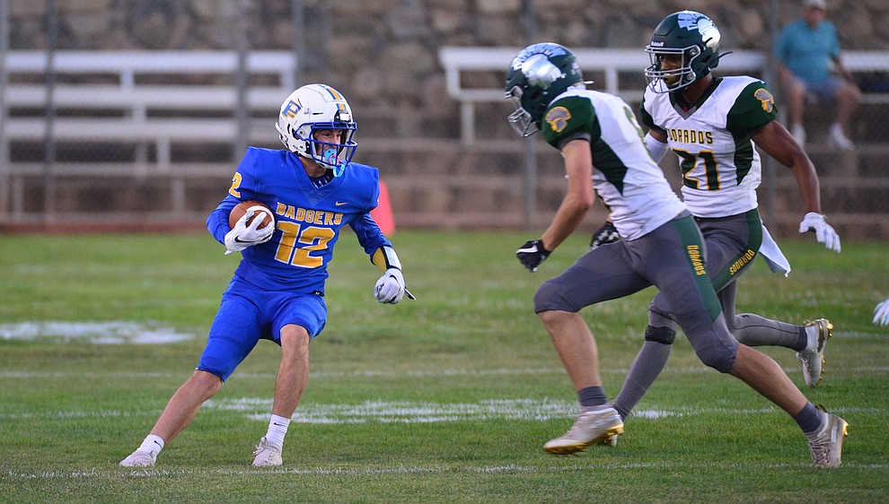Prescott's Brayden Nelson runs after a catch as the Badgers held their 2019 home opener at Ken Lindley Field Friday, Aug. 30, 2019.  (Les Stukenberg/Courier)