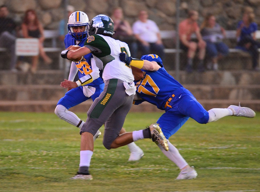 Prescott's Hayden Mckown makes an open field tackle as the Badgers held their 2019 home opener at Ken Lindley Field Friday, Aug. 30, 2019.  (Les Stukenberg/Courier)