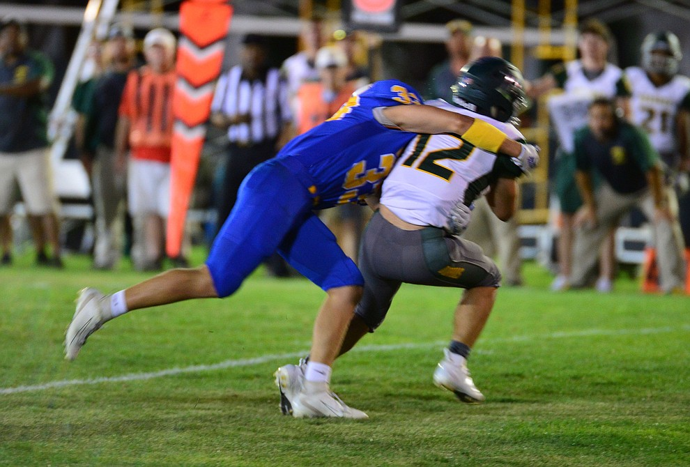 Prescott's Rhett Pearce sacks the quarterback as the Badgers held their 2019 home opener at Ken Lindley Field Friday, Aug. 30, 2019.  (Les Stukenberg/Courier)
