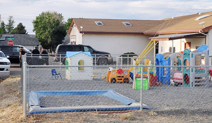 Police search the Gummy Bear Early Learning Center, in the 8000 block of Manley Drive, Prescott Valley, Thursday evening, July 11, 2019, as part of an investigation into complaints of child abuse. They also searched an associated Gummy Bear Childcare business on Spouse Drive. (Tim Wiederaenders/Courier, file)