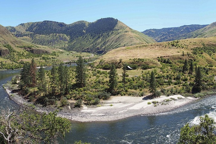 This undated photo provided by Loren Davis in August 2019 shows an overview of the Cooper's Ferry canyon in western Idaho. In a report released on Thursday, Aug. 29, 2019, scientists say they've found artifacts in the area that indicate people were living here around 16,000 years ago, providing new evidence that the first Americans entered their new home by following the Pacific Coast. (Loren Davis)