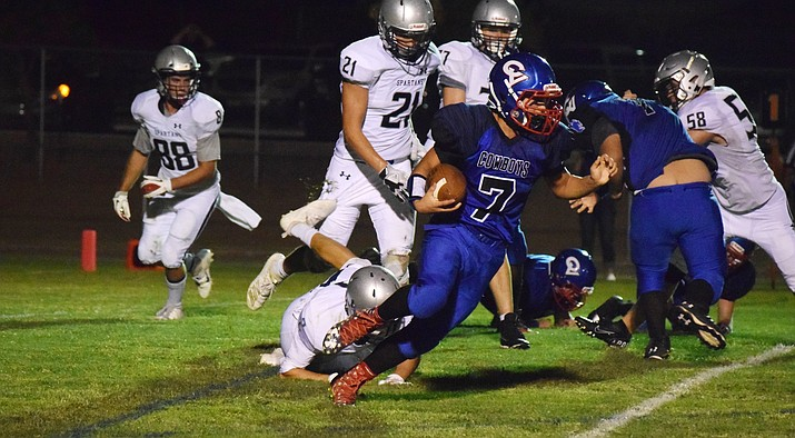 Camp Verde sophomore Jacob Oothoudt breaks a tackle during the Cowboys' 44-8 loss to Scottsdale Prep on Friday at home in CV's season opener. VVN/James Kelley