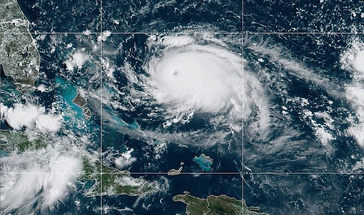 Forecasters expect Dorian, packing 150 mph winds, to hit the northwestern Bahamas on Sunday before curving upward. (NOAA photo)