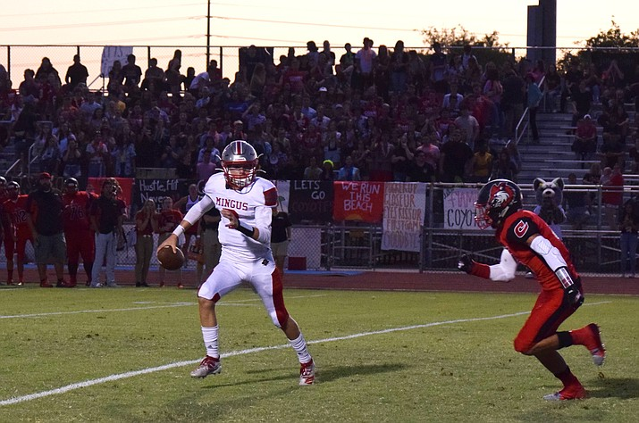 Mingus sophomore Zachary Harrison scrambles during the Maruaders' 36-21 loss at San Tan Valley Combs on Aug. 23. VVN/James Kelley