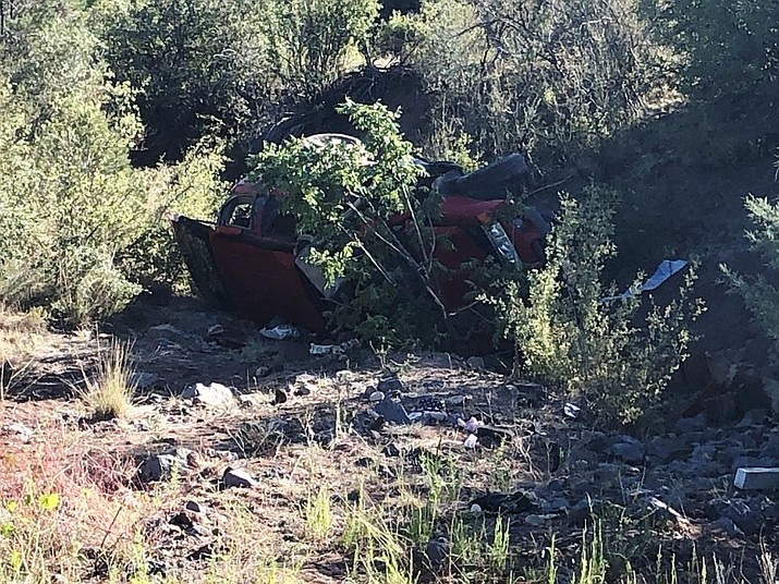 A red Saturn station wagon sits in a ditch near mile marker three off Williamson Valley road outside of Prescott. A rollover collision claimed the life of an 18-year-old driver early Saturday morning, according to a Yavapai County Sheriff's Office (YCSO) release. (YCSO/Courtesy)
