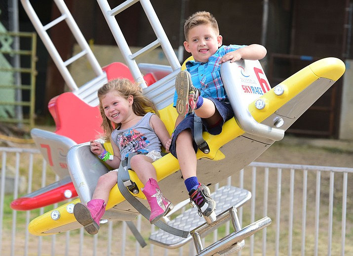 Prescott's Peyton and Waylon Hager ride the Skyrace at the 2017 Yavapai County Fair at the Prescott Rodeo Grounds in Prescott. The 2019 fair runs Thursday, Sept. 5 to Sunday, Sept. 8 at 850 Rodeo Drive. (Les Stukenberg/Courier)