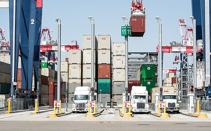 Trucks wait to be loaded at the port in Long Beach, Calif. Arizona officials are concerned about the impact of new tariffs taking effect Sept. 1 on $300 billion in Chinese goods imported into the U.S. (Photo by Dennis Schroeder, NREL/Creative Commons)