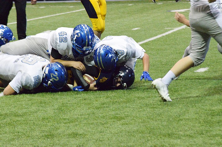 A group of Bagdad defenders jump on top of a Joseph City runner as the Sultans went on to a 54-12 win at the Walkup Skydome on Saturday, Aug. 31, 2019, in Flagstaff. (Sylvia Andrews/Courtesy)