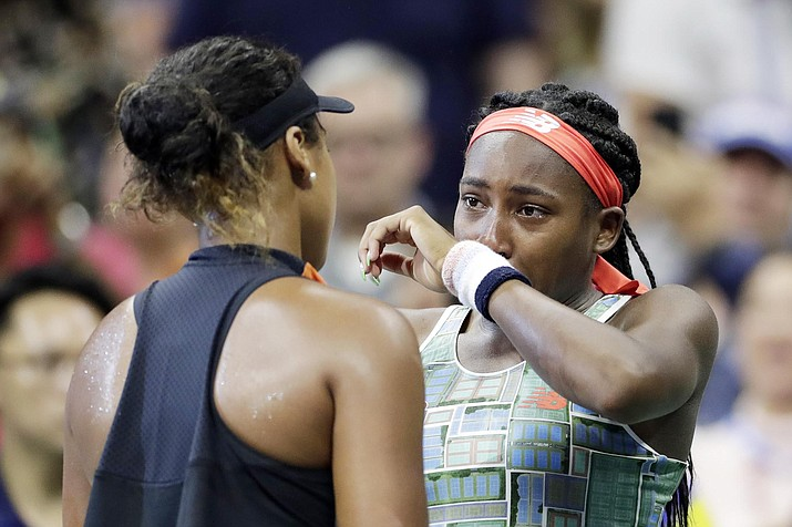 Coco Gauff, right, of the United States, wipes away tears while talking to Naomi Osaka, of Japan, after Osaka defeated Gauff during the third round of the U.S. Open tennis tournament Saturday, Aug. 31, 2019, in New York. (Adam Hunger/AP)