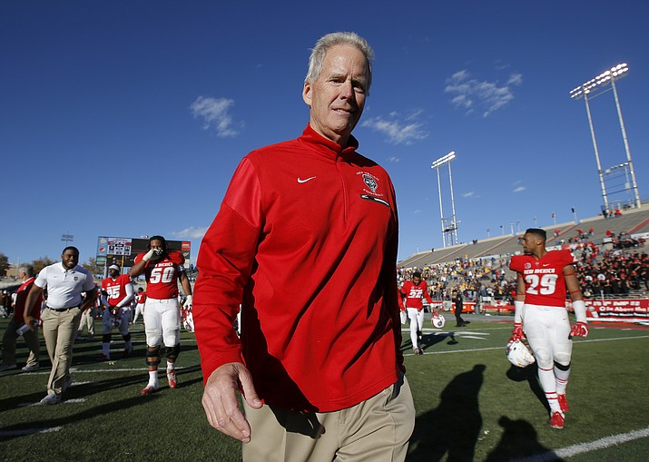 "In this Nov. 24, 2018, file photo, New Mexico coach Bob Davie walks off the field after the team's NCAA college football game against Wyoming in Albuquerque, N.M. New Mexico says Davie was taken to the hospital after what it called ""a serious medical incident,"" following the team's he team's game Saturday night, Aug. 31, against Sam Houston State. Athletic director Eddie Nunez released a statement after the Lobos won 39-31 at home in Albuquerque, New Mexico. Nunez said the university will release more information as it becomes available. (Andres Leighton/AP, File)"