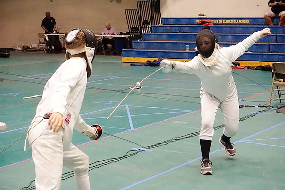 Cassiopeia Andradottir of Salle d'Escrime of Prescott competes during the 25th Annual Prescott Fall Fencing Tournament at Prescott High School on Sunday, Sept. 1, 2019. (Aaron Valdez/Courier)
