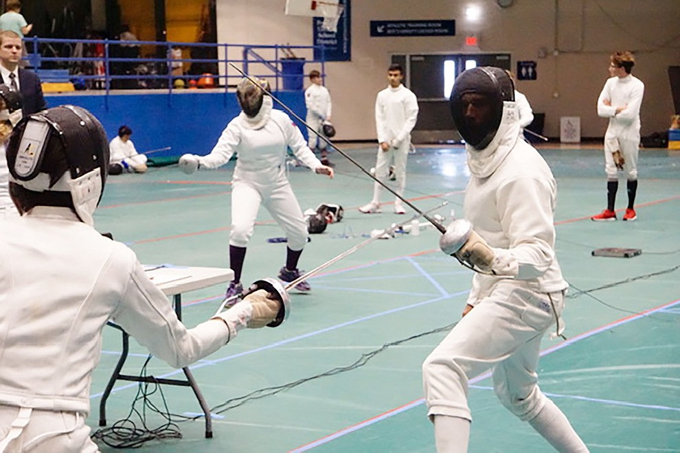 Eric Thogerson (right) of Salle d'Escrime of Prescott competes during the 25th Annual Prescott Fall Fencing Tournament at Prescott High School on Sunday, Sept. 1, 2019. (Aaron Valdez/Courier)