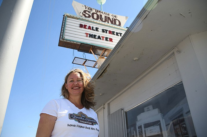 Kristina Michelson, Kingman Center for the Arts executive director, stands in front of the Beale Street Theater in this file photo. The theater only needs $50,000 more to reach its goal as part of the Angle Homes Matching Grant Challenge. (Daily Miner file photo)