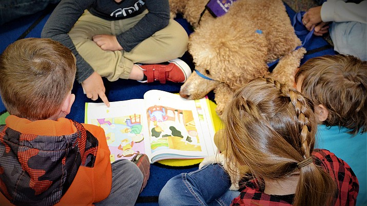 Prescott Unified School District students read to Bailey, as part of the Pet Partners of Prescott programs within the district. (PUSD/Courtesy)