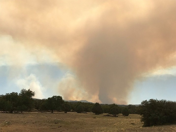 Smoke from the Sheridan Fire is seen Sunday, Sept. 1, 2019, as it burns 23 miles north of Prescott. Local storms slowed the progress of the fire Sunday, and it is now 49% contained. (PNF/Courtesy)