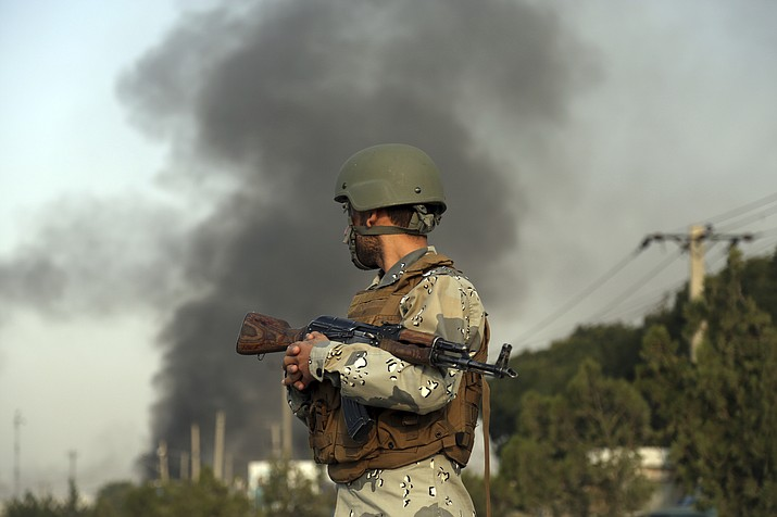 Smoke rises as angry Kabul residents set fire to part of the Green Village compound that has been attacked frequently, a day after a Taliban suicide attack in Kabul, Tuesday, Sept. 3, 2019. (AP Photo/Rahmat Gul)