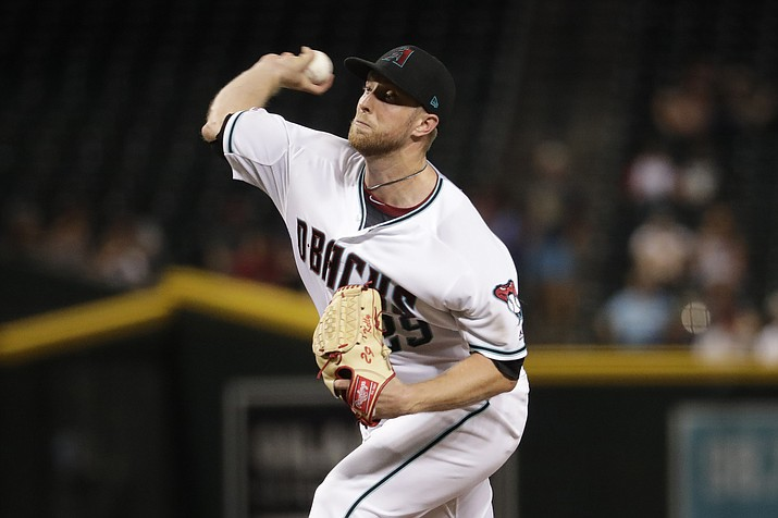 Arizona Diamondbacks starting pitcher Merrill Kelly throws to a San Diego Padres during the seventh inning of a game Tuesday, Sept. 3, 2019, in Phoenix. (Matt York/AP)