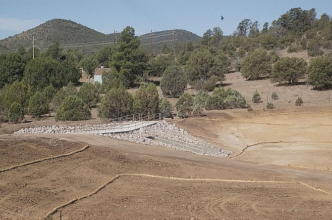 The Ho Kay Gan regional storm water detention basin project is nearly complete, just north of the Liberty Baptist Church on Williamson Valley Road. (Tim Wiederaenders/Courier)