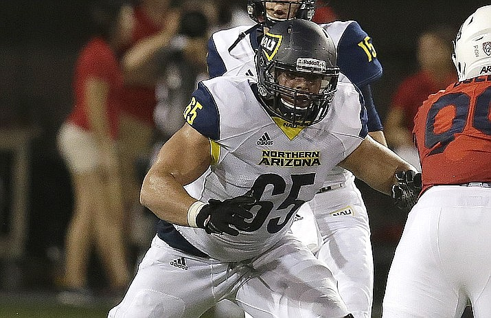 NAU offensive lineman Malik Noshi (65) in a game against Arizona, Saturday, Sept. 2, 2017, in Tucson, Ariz. A friend discovered the 22-year-old senior offensive lineman unconscious in his Flagstaff home in early July. Emergency responders pronounced him dead. (Rick Scuteri/AP)