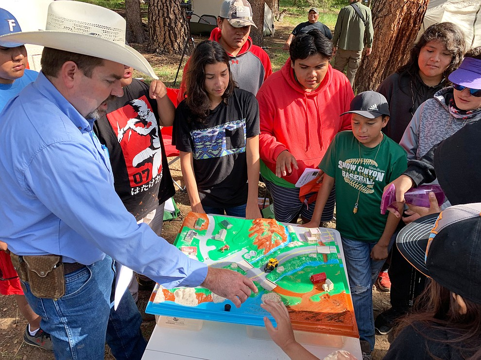 BLM Botanist Raymond Brinkerhoff uses an interactive-3D Watershed model to teach campers about plants and to demonstrate the impacts humans have on our water sources. 8-3-19. 190803-BLM-GSENM-Hercher-IMG_7108. Photo by BLM Public Affairs Specialist David Hercher.