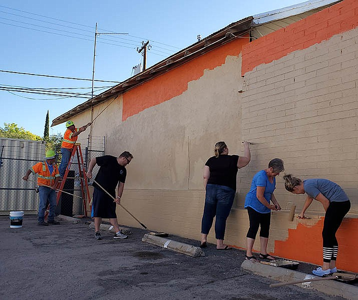 Having received permission from the U.S. Marshal's Service to paint the building that was formerly Smokin' Body Jewelry, the City's senior management team and the Kingman Area Chamber of Commerce board of directors came together in the early hours of Wednesday, Aug. 28 to give it a facelift. It took the group of about a dozen people 2 1/2 hours to finish the first phase of the painting project. (Daily Miner photo)