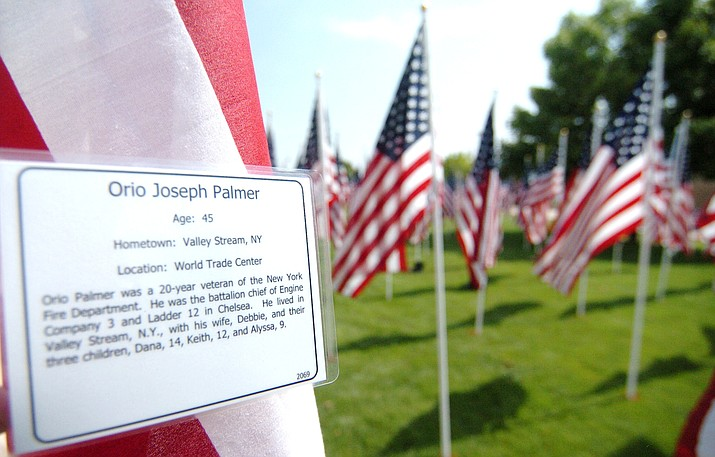 Every flag tells a story at Healing Field display, which presents thousands of U.S. flags in a beautiful formation at the Prescott Valley Civic Center every year. Volunteers will begin placing flags Friday, Sept. 6, 2019. (Les Stukenberg/Courier, file)