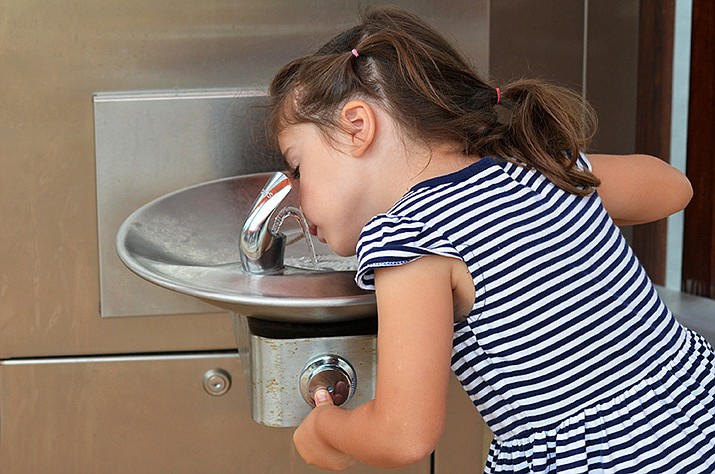 we should all be able to agree that children need safe drinking water at school. (Adobe Images)