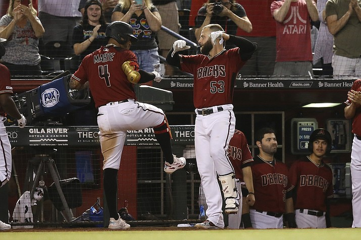 Arizona Diamondbacks' Ketel Marte (4) celebrates his grand slam against the San Diego Padres with Christian Walker (53) during the seventh inning of a game Wednesday, Sept. 4, 2019, in Phoenix. (Ross D. Franklin/AP)