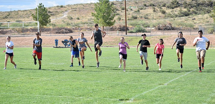 Camp Verde cross country runners warm up at practice on Tuesday afternoon. VVN/James Kelley