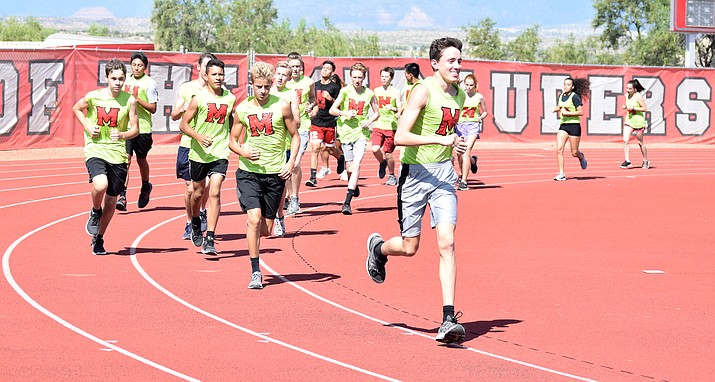 Mingus cross country runners warm up for practice on Wednesday afternoon. The Marauders have bright colored shirts to run in so they're more visible around town. VVN/James Kelley