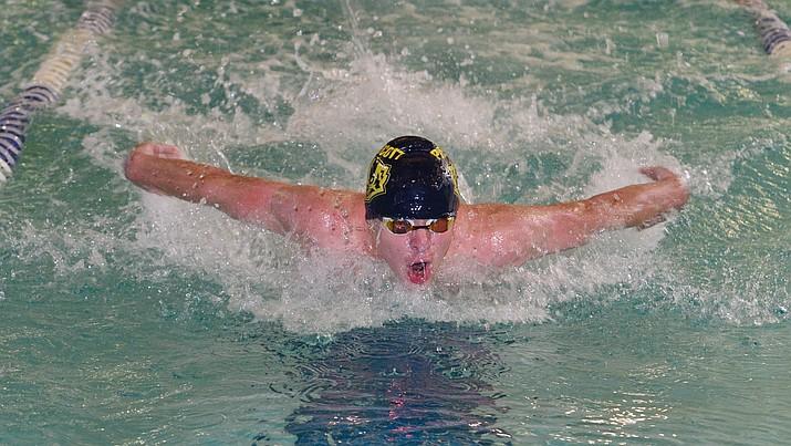 Prescott's Dane Bassett swims the butterfly in the  medley relay as the Badgers host Arizona College Prep in a dual swim meet Thursday, Sept. 5, 2019, at the Prescott YMCA.  (Les Stukenberg/Courier)