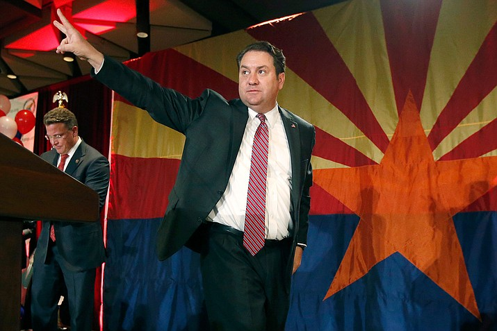 In this Nov. 4, 2014 file photo, Arizona Republican Attorney General Mark Brnovich waves to supporters at the Republican election night party in Phoenix. Brnovich is siding with President Trump in his efforts to dissolve the Obama-era Deferred Action for Childhood Arrivals program. (Ross D. Franklin/AP, file)