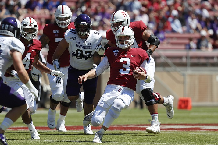 Stanford quarterback K.J. Costello (3) runs with the ball against Northwestern defensive lineman Joe Gaziano (97) in the first quarter of a game in Stanford, Calif., Saturday, Aug. 31, 2019. (Josie Lepe/AP)