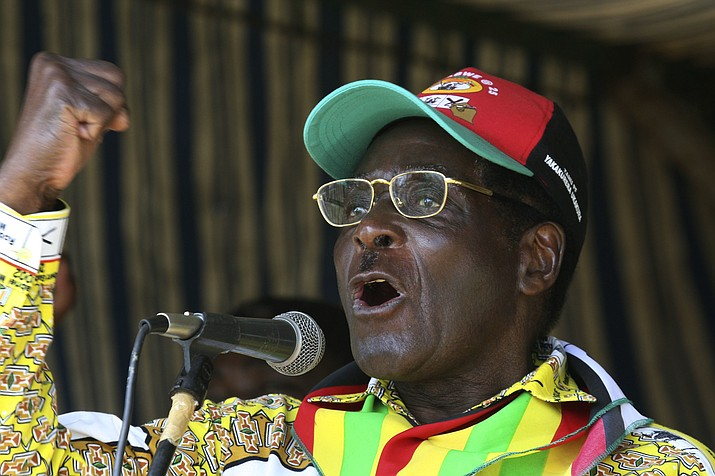 In this Tuesday, March 18, 2008 file photo, Zimbabwe President Robert Mugabe addresses party supporters at a rally in Gweru, about 250 kms. (155 miles) south of Harare. On Friday, Sept. 6, 2019, Zimbabwe President Emmerson Mnangagwa said his predecessor Robert Mugabe, age 95, has died. (AP Photo/Tsvangirayi Mukwazhi, file)