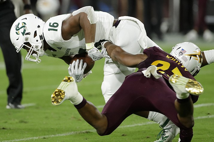 Sacramento State tight end Marshel Martin (16) is tackled by Arizona State linebacker Tyler Whiley during the first half of an NCAA college football game Friday, Sept. 6, 2019, in Tempe, Ariz. (Matt York/AP)