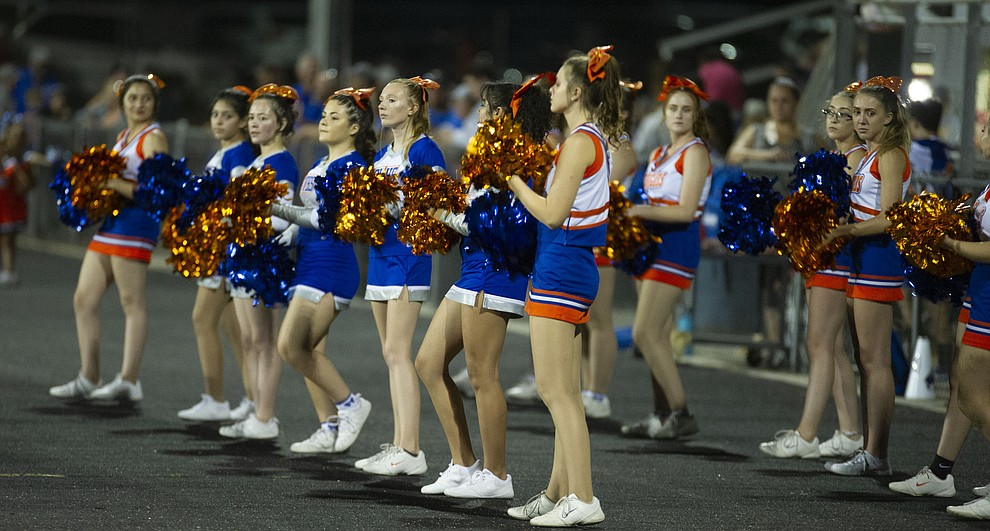 Chino Valley's cheerleaders were busy in the first half as the Cougars hosted Tuba City Friday, Sept. 6, 2019. (Les Stukenberg/Courier)