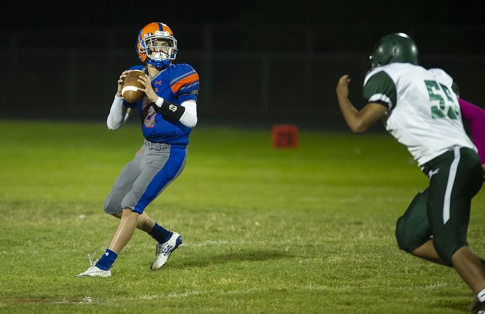 Chino Valley's Jayden Smith (8) sets to throw as the Cougars hosted Tuba City Friday, Sept. 6, 2019. (Les Stukenberg/Courier)