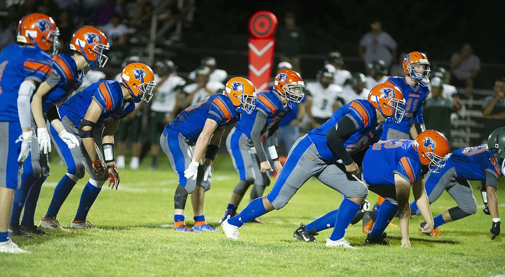Chino Valley's defense played staunchly in the first half as the Cougars hosted Tuba City Friday, Sept. 6, 2019. (Les Stukenberg/Courier)