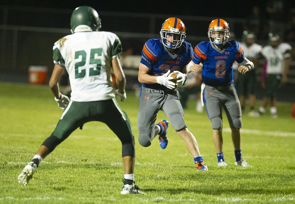 Chino Valley's Trevor Gianfrancesco (38) runs to the outside as the Cougars hosted Tuba City Friday, Sept. 6, 2019. (Les Stukenberg/Courier)
