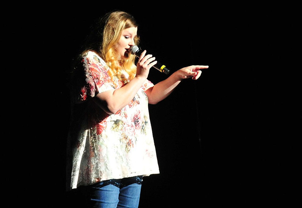 """Robin Fitch, from Prescott Valley, sings """"A Broken Wing"""" during the finale of the 2019 Prescott Sings Competition Thursday, Sept. 5, 2019, at the Yavapai College Performing Arts Center in Prescott.  (Les Stukenberg/Courier)"""