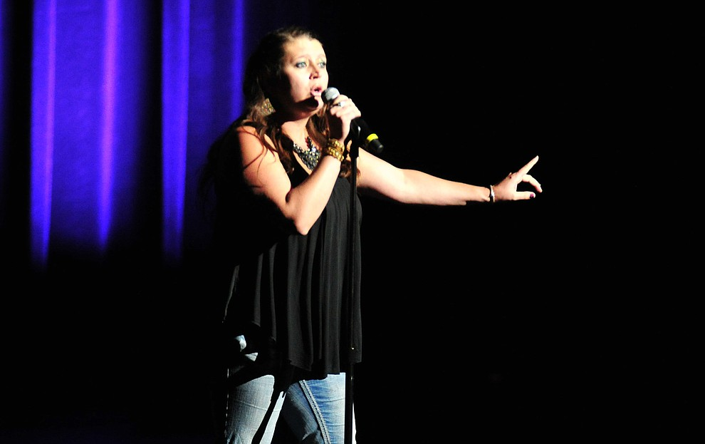 """Julie Malinowski, from Prescott, sings If I Could Turn Back Time"""" during the finale of the 2019 Prescott Sings Competition Thursday, Sept. 5, 2019, at the Yavapai College Performing Arts Center in Prescott.  (Les Stukenberg/Courier)"""