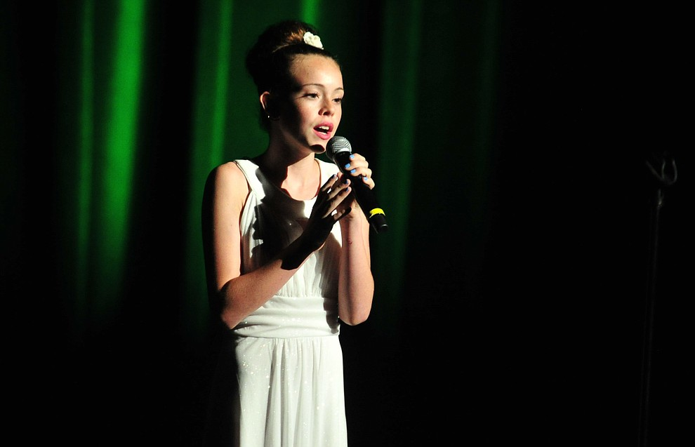 """Chino Valley's Sydney Jensen sings """"A Million Dreams"""" during the finale of the 2019 Prescott Sings Competition Thursday, Sept. 5, 2019, at the Yavapai College Performing Arts Center in Prescott.  (Les Stukenberg/Courier)"""
