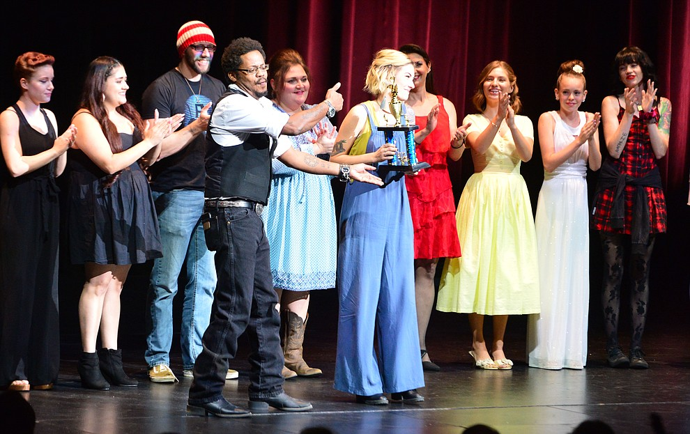 2016 winner D.L. Harrison presents the third place trophy to  Abigail Kelley following the finale of the 2019 Prescott Sings Competition Thursday, Sept. 5, 2019, at the Yavapai College Performing Arts Center in Prescott.  (Les Stukenberg/Courier)