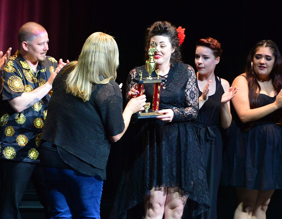 2017 winner Tiffani Fortney presents the second place trophy to Lyndsay Cross following the finale of the 2019 Prescott Sings Competition Thursday, Sept. 5, 2019, at the Yavapai College Performing Arts Center in Prescott.  (Les Stukenberg/Courier)